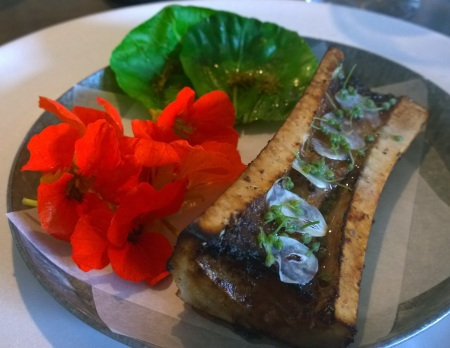 Roasted Bone Marrow with Cabbage and Nasturtium Flowers